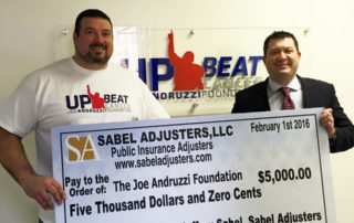 Jeff Sabel with a member of the Joe Andruzzi Foundation